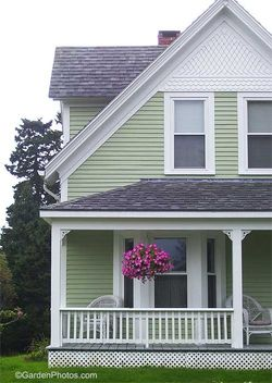 House in Maine with a petunia basket. Image ©GardenPhotos.com