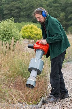 Entomologist Andy Salisbury uses a Vortis suction sampler to collect insects in the Plants for Bugs experimental plots at Wisley